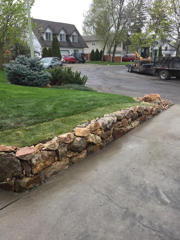 a retaining wall bordering a garden