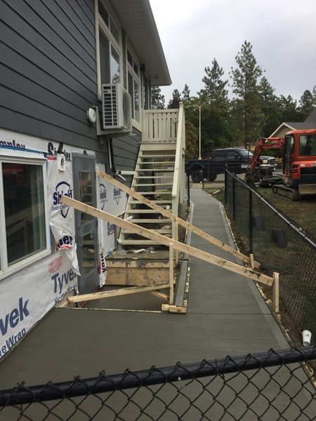 stairs being built on the outside of a house