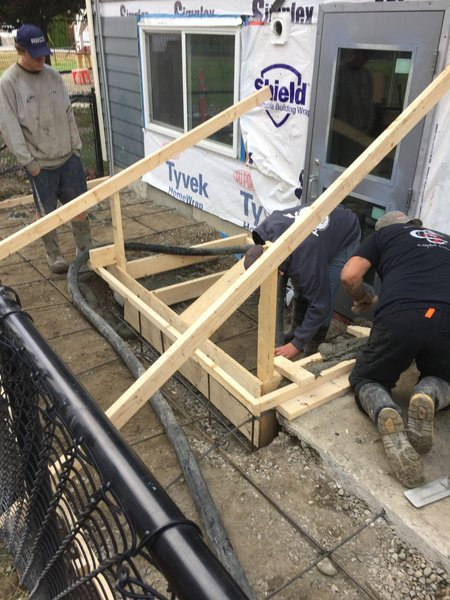 men working on building stairs
